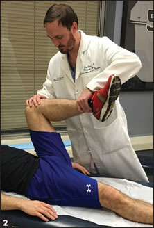 patient being tested for AIIS impingement