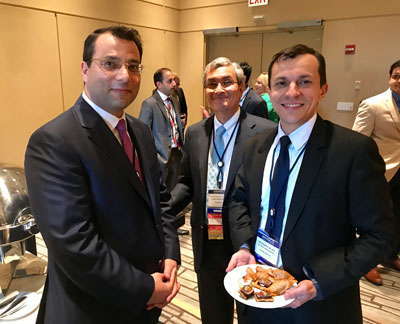 Derek Raghavan, MD, PhD (center), HemOnc Today's Chief Medical Editor for oncology, congratulates Mohamed E. Salem, MD (left), and Yanis Boumber, MD, PhD, on their selection as Next Gen Innovators.