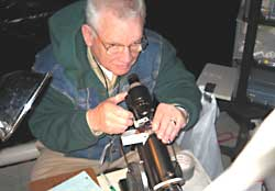Hubert Thompson performs lensometry on a patient's glasses