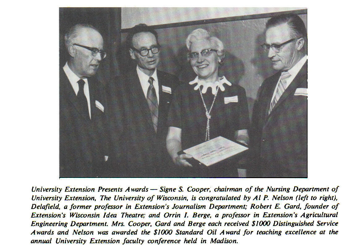 University Extension Presents Awards - Signe S. Cooper, chairman of the Nursing Department of University Extension, The University of Wisconsin, is congratulated by Al P. Nelson (left to right), Delafteld, a former professor in Extension's Journalism Department; Robert E. Gard, founder of Extension's Wisconsin Idea Theatre; and Orrin I. Berge, a professor in Extension's Agricultural Engineering Department. Mrs. Cooper, Gard and Berge each received $1000 Distinguished Service Awards and Nelson was awarded the $1000 Standard Oil Award for teaching excellence at the annual University Extension faculty conference held in Madison.