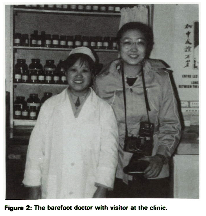 Figure 2: The barefoot doctor with visitor at the clinic.