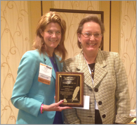 Donna M. Fick, PhD, RN, FGSA, FAAN, Editor (left), presents the Edna Stilwell Writing Award to Marianne Smith, PhD, RN, during the Gerontological Society of America's annual conference in New Orleans.