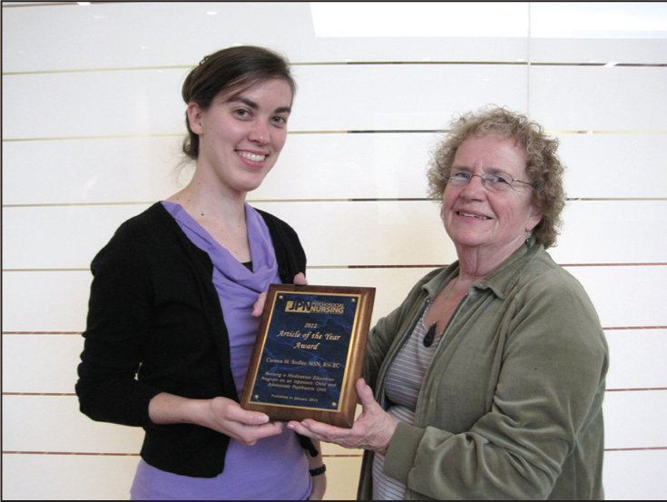 Shirley A. Smoyak, RN, PhD, FAAN, Editor (right), presents the JPN 2012 Article of the Year Award to Carmen M. Stoller, MSN, RN-BC, during the American Psychiatric Nurses Association annual conference in Pittsburgh, Pennsylvania.