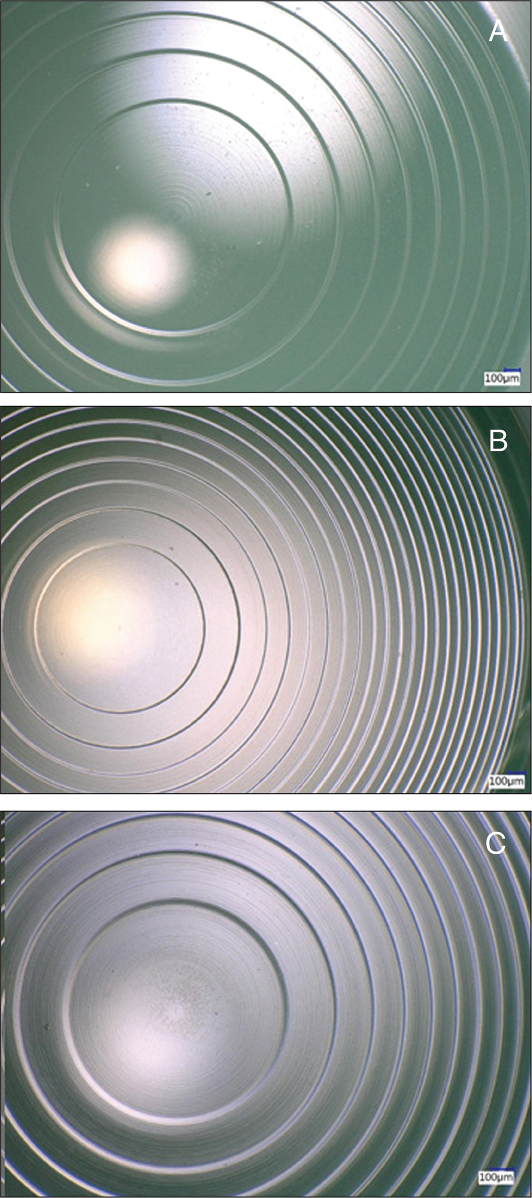 Microscopy pictures of the intraocular lens (IOL) surface: (A) extended depth of focus IOL; (B) trifocal IOL; and (C) bifocal IOL.