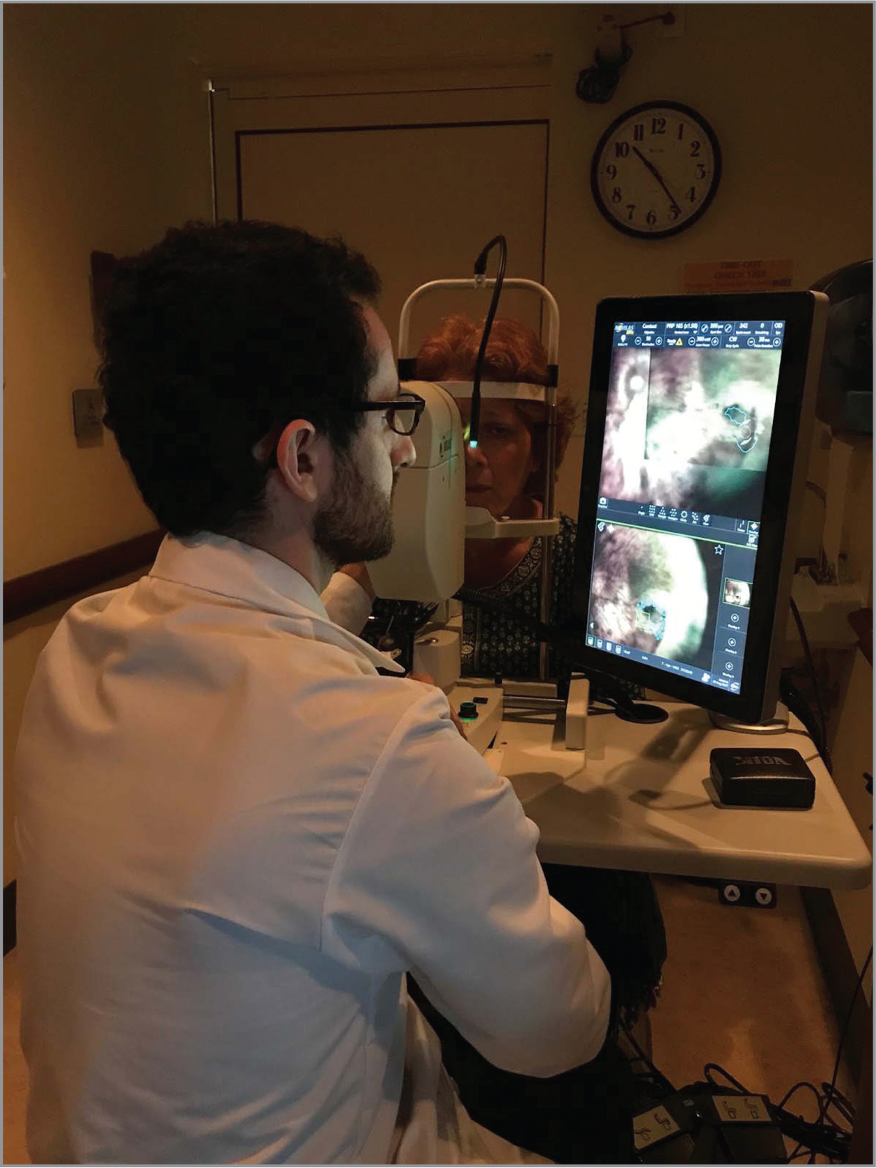"Operating the Navilas laser: Interaction with the system occurs over a touch-screen display in a ""heads-up"" posture."