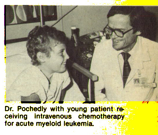 Dr. Pochedly with young patient receiving intravenous chemotherapy for acute myeloid leukemia.