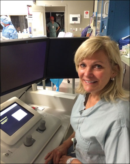 Cindy L. Grines, MD, at the control console of a vascular robotic system for PCI procedures. According to Grines, robotic-assisted PCI helps to increase the precision of stent and balloon placement while reducing physical fatigue and exposure to radiation.