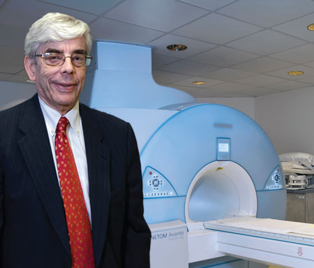 Reichek stands in front of St. Francis Hospital's MRI system when it was upgraded in 2012. It was the first 32-channel system on Long Island.