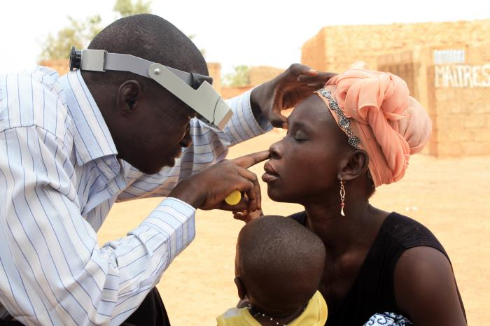 Photo of a woman getting checked for trachoma