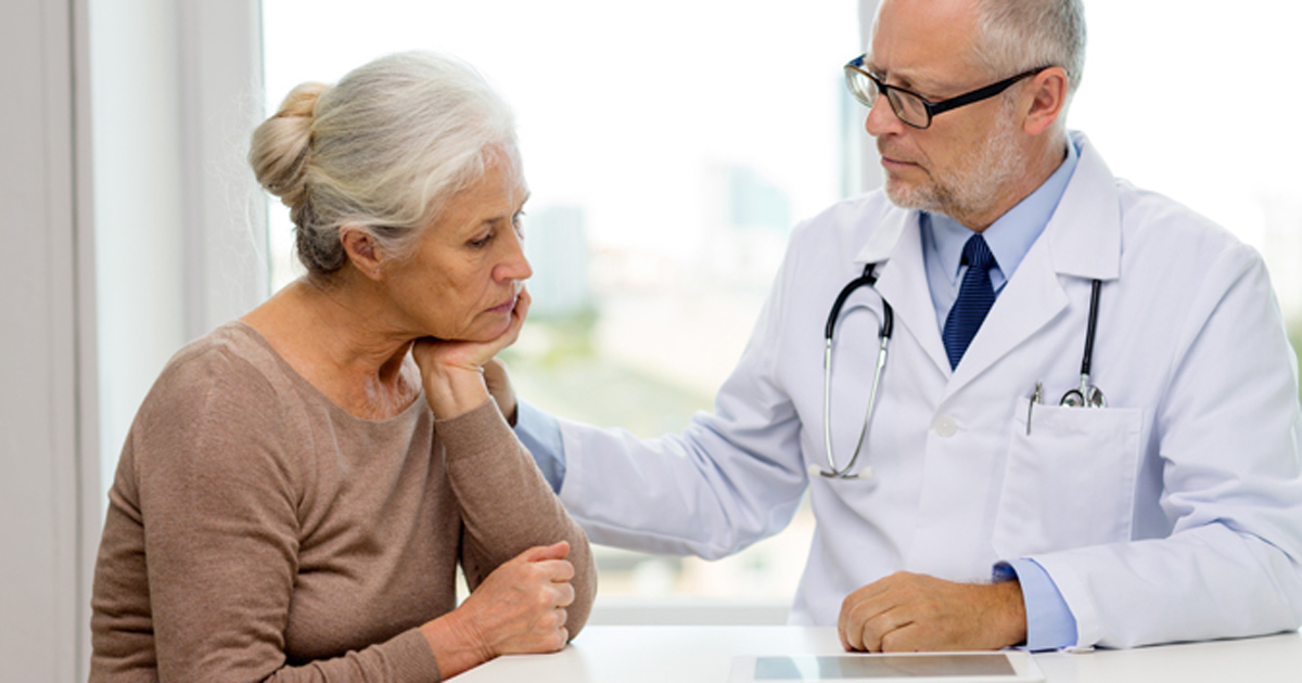 Doctor with depressed elderly patient