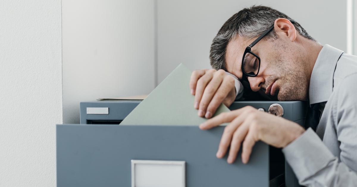 Man asleep at filing cabinet