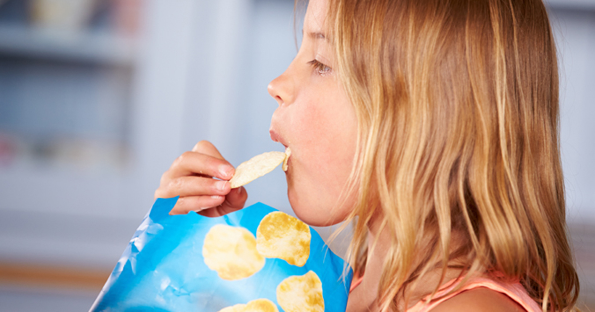 Child eating potato chips