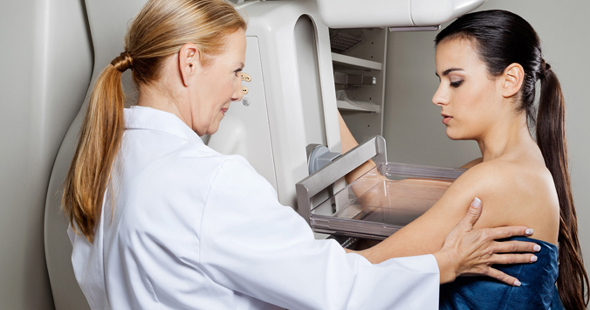 photo of woman undergoing mammogram