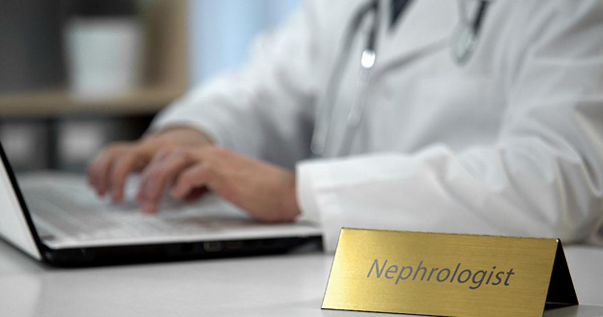 Nephrologist at desk