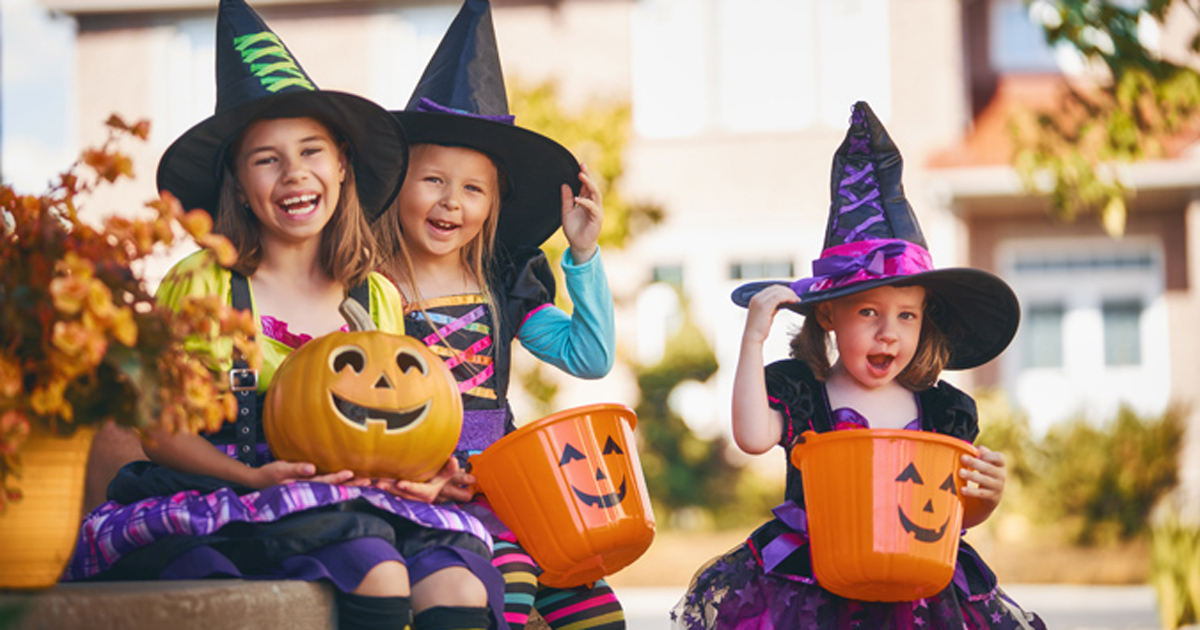 Kids dressed as witches on Halloween trick-or-treating