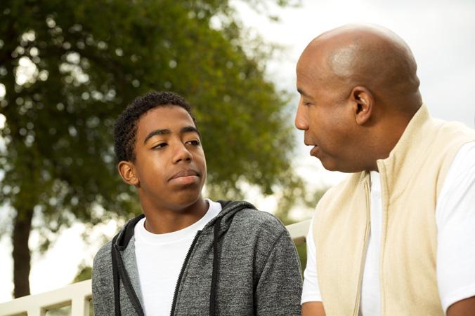 Parent speaks with teenage son