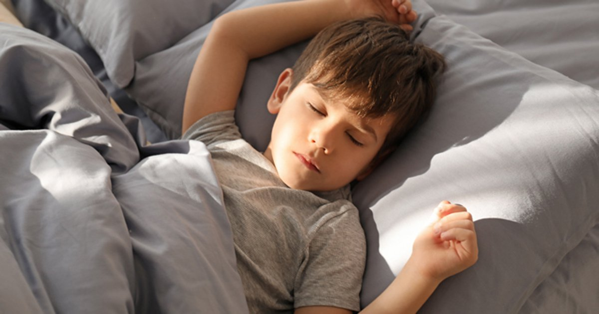 Photo of young boy sleeping